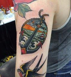 Traditional anchor and lighthouse  - 100 Anchor Tattoos