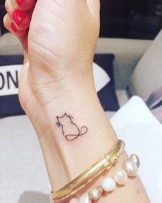 10 adorable, minimal animal tattoo - Over 100 Cat Tattoos, Designs and Tattoo Ideas