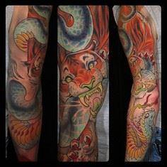 Kitty sleeve from Curtis Burgess.  - Over 100 Cat Tattoos, Designs and Tattoo Ideas