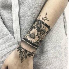 Floral cuff tattoo by Vlada Shevch - 200 Floral Tattoos - Beautiful Flower Designs, Ideas for Tattoos