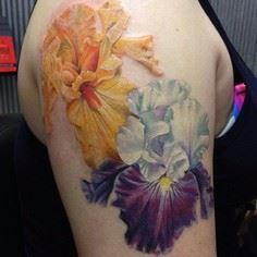 Purple Iris is healed. Added the orange one - thanks Kristin for a fun project - foliage to come. @eternalink @neotatmachines #flowertattoo #iristattoo…
