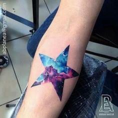 Galaxy in a star - 50 Galaxy Tattoos - Earth Shattering Space Tattoos