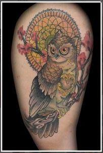 Owl with dream catcher behind - 50 Owl Tattoos You Have to See