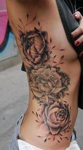 roses on side of body - 140 Rose Tattoos