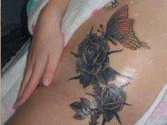Dark rose tattoo with a butterfly. - 185 Thigh Tattoos